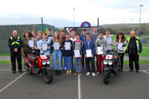 Sandown Bay Academy safer rider course for mopeds. The students who took part in the Pre-Rider Educational Course with Paul Spreadbury from Pit-Stop Training, left, and Fire and Rescue Service safety officer Mervyn Goldring, right.